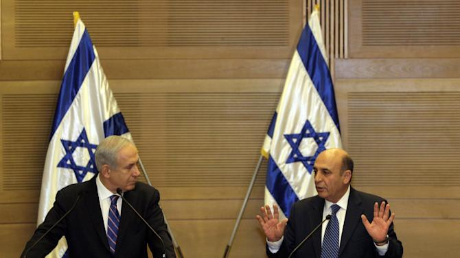 FILE- In this May 8, 2012 file photograph, Israel's Prime Minister Benjamin Netanyahu, left, and Kadima party leader Shaul Mofaz hold a joint press conference in Jerusalem.  Israel plunged toward a political crisis Tuesday, July 17, 2012, after the Kadima Party, the largest party in the government quit, leaving Prime Minister Benjamin Netanyahu in charge of a hard-line coalition opposed to most Mideast peace moves. The moderate Kadima Party voted to pull out of the government in a feud over attempts to reform the country's military draft. (AP Photo/Sebastian Scheiner, File)