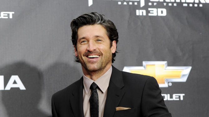 """FILE - In this June 28, 2011 file photo, actor Patrick Dempsey attends the """"Transformers: Dark Of The Moon'"""" premiere in Times Square in New York. Late Thursday night Jan. 3, 2013, Dempsey announced that his company, Global Baristas LLC, made the winning bid for Tully's Coffee.  (AP Photo/Evan Agostini, File)"""