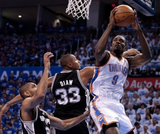 Serge Ibaka (R) contributed some unexpected offence, scoring 26 points on perfect 11-for-11 shooting for the Thunder