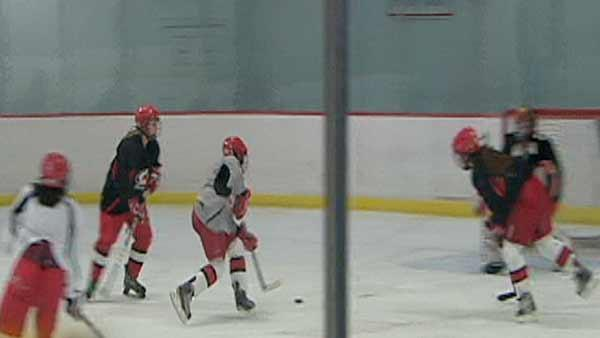 Youth female hockey players hit the ice