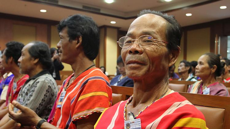 Karen villager Yaserh Nasuansuwan, right, sits with his compatriots for a court session against Thai Pollution Control Department at the administrative court in Bangkok, Thailand, Thursday, Jan. 10, 2013. The court has ordered the government agency to rehabilitate a lead-polluted creek and pay nearly four million US dollars in compensation to local villagers in a long-awaited environmental legal battle. More than 150 ethnic Karen villagers near the Klity Creek in Kanchanaburi province have suffered from lead-contamination in water, soil and aquatic animals for over 10 years. The toxic waste was released from a mining factory that was shut down in 1998. (AP Photo/Apichart Weerawong)