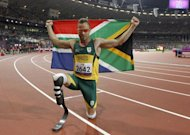 South Africa's Oscar Pistorius poses after winning gold in the men's 400m - T44 final during the athletics competition at the London 2012 Paralympic Games