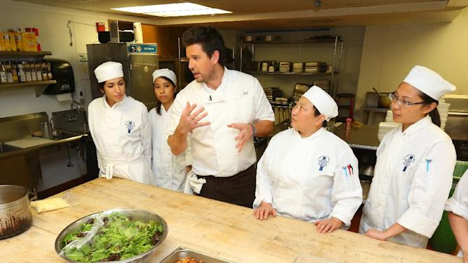 "Ryan Scott, Market & Rye executive chef and former ""Top Chef"" contestant, speaks to California Culinary Academy students at a McDonald's culinary event for charity. The event was held at the California Culinary Academy on Thursday, Oct. 4, 2012, in San Francisco. Three well-known Bay Area chefs prepared nine signature dishes, made from ingredients found at  your local McDonalds. (Photo by Tomas Ovalle/Invision for McDonald's/AP Images)"