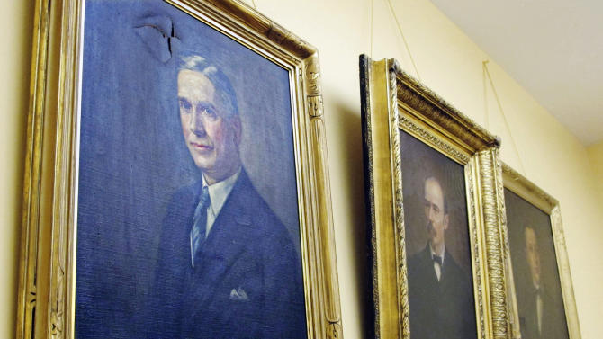 In this Jan. 3, 2013 photo, portraits of former Lt. Govs. John T. Brown, left, Andrew Hickenlooper, center, and Clarence J. Brown hang in a meeting room at the Statehouse in Columbus, Ohio, as they await restoration. Artists often put oil to canvas at this time of year to render official portraits of a governor or legislative leader who's coming or going from office. (AP Photo/Kantele Franko)