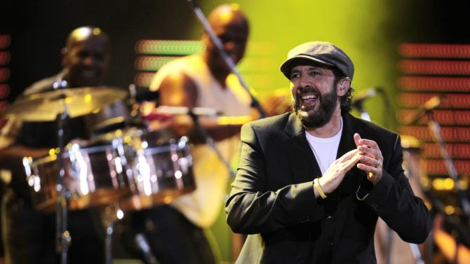 FILE - In this Feb. 27, 2012 file photo, Dominican Republic singer Juan Luis Guerra performs at the 53rd annual Vina del Mar International Song Festival in Vina del Mar, Chile. Guerra tops the list of the 2012 Latin Grammy nominees with six nominations, including song of the year and record of the year. The 13th edition of the Latin Grammy Awards is scheduled for Nov. 15 in Las Vegas. (AP Photo/Jorge Saenz, File)
