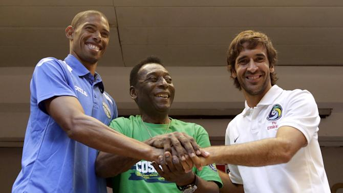 Cuba's soccer player Marquez, former Brazilian soccer star Pele and New York Cosmos player Raul shake hands after a news conference in Havana