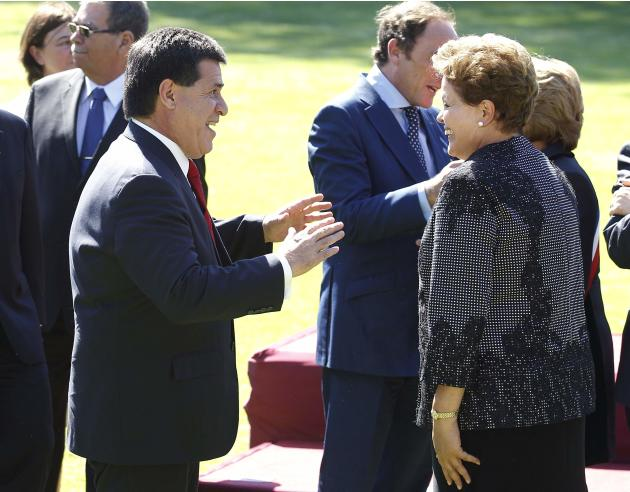 Paraguay's president Cartes, speaks with Brazil's president Rousseff after a meeting at Cerro Castillo Presidential Palace with Chilean president Bachelet in Vina del Mar city