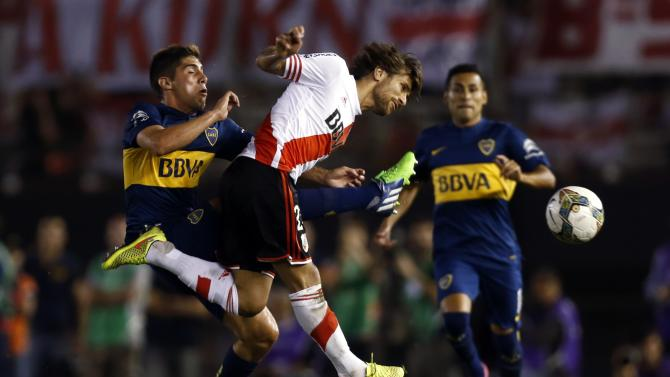 River Plate's Ponzio and Boca Juniors' Erbes fight for the ball during their Copa Sudamericana second round semi-final soccer match in Buenos Aires