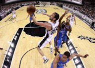 San Antonio Spurs&#39; Manu Ginobili shoots during game one of the NBA Western Conference Finals on May 27. The Spurs turned it on in the fourth quarter to beat Oklahoma 101-98