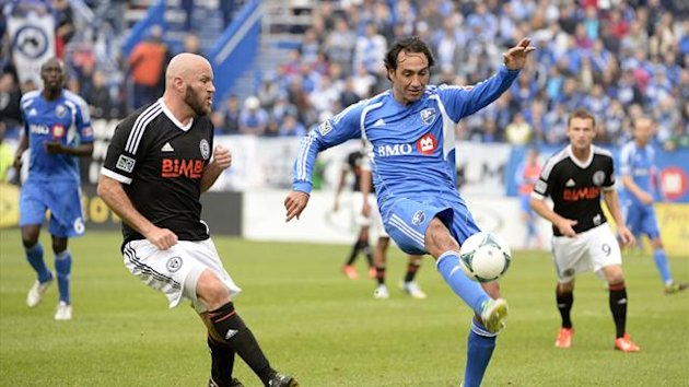 Montreal Montreal Impact defender Alessandro Nesta (14) plays the ball in front of Philadelphia Union forward Conor Casey (6) during the second half at Stade Saputo (Reuters)