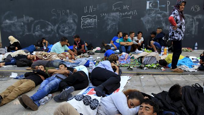 Migrants rest at an underground station near the main Eastern Railway station in Budapest