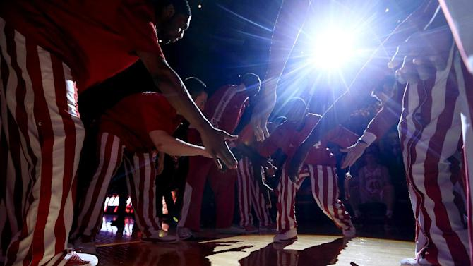 Indiana's Victor Oladipo is greeted by teammates during introductions before an NCAA college basketball game against Ohio State, Tuesday, March 5, 2013, in Bloomington, Ind. (AP Photo/Darron Cummings)