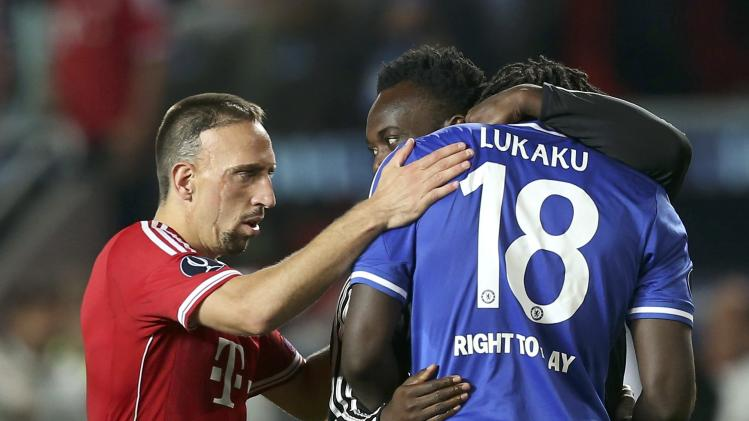 Chelsea's Romelu Lukaku is comforted by team mates after he failed to score the final penalty during the UEFA Super Cup soccer final against Bayern Munich at Eden stadium in Prague