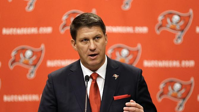 New Tampa Bay Buccaneers general manager Jason Licht gestures during an NFL football news conference Thursday, Jan. 23, 2014, in Tampa, Fla. Licht becomes the fifth general manager in team history.  He takes over a team that hasn't made the playoffs since 2007