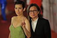 Hong Kong actress Sandra Ng (L) and director Peter Chan (R) pose for pictures while walking down the red carpet at the 31st Hong Kong Film Awards in April 2012. Chan and British actress Samantha Morton will be on a jury presided by US producer Michael Mann for the Venice film festival starting next month