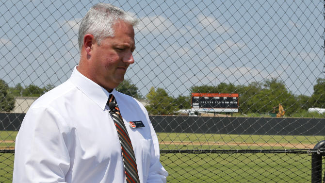 Jeff Williams, director of athletics at East Central University, prepares to talk about Christopher Lane during an interview at the baseball field at East Central University in Ada, Okla., Wednesday, Aug. 21, 2013. Australian Christopher Lane, who was on a baseball scholarship at East Central University was in Duncan, Okla., visiting his girlfriend, when he was shot and killed. (AP Photo/Sue Ogrocki)