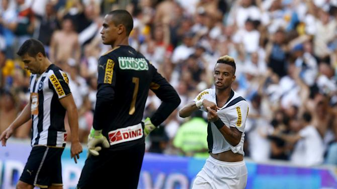 Brazil's Silva celebrates his goal  as goalkeeper Renan from Botafogo reacts during their Carioca Championship final soccer match at the Maracana stadium in Rio de Janeiro