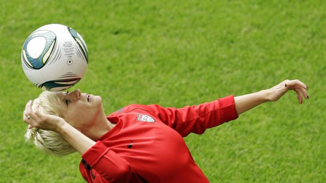 United States' Megan Rapinoe juggles the ball with her head during a training session in preparation for a match against Sweden during the Women's Soccer World Cup in Wolfsburg, Germany, Tuesday, July 5, 2011. (AP Photo/Marcio Jose Sanchez)