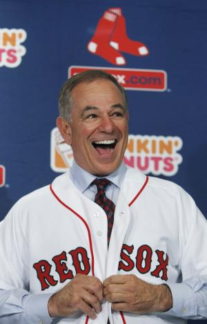 Boston Red Sox manager Bobby Valentine laughs as he puts on a jersey during a news conference at Fenway Park in Boston, Thursday Dec. 1, 2011.  The 61-year-old former Rangers and Mets skipper was introduced Thursday during a news conference at Fenway Park. Valentine is the 45th manager of the Boston Red Sox. (AP Photo/Charles Krupa)