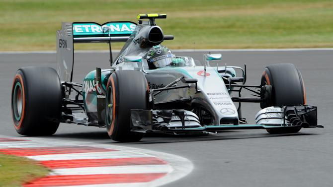 German Mercedes driver Nico Rosberg steers his car at Luffield corner during the third training session for the British Formula One Grand Prix at Silverstone circuit, Silverstone, England, Saturday, July 4, 2015. The British Formula One Grand Prix will be held at Sunday July 5. (AP Photo/Rui Vieira)