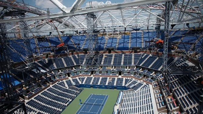 A view of the Arthur Ashe Stadium where the final piece of steel for the roof structure is being installed at the USTA Billie Jean King National Tennis Center in New York City on June 10, 2015