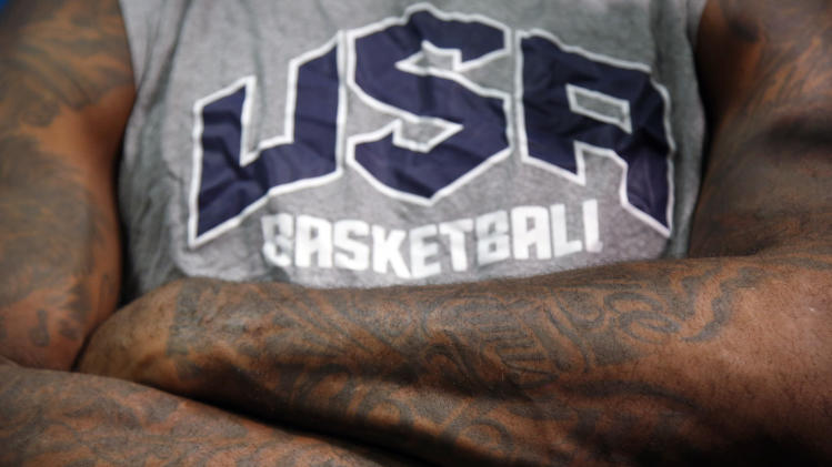 United States forward LeBron James crosses his arms as he talks to reporters during a men's team basketball practice at the 2012 Summer Olympics, Saturday, July 28, 2012, in London. (AP Photo/Jae C. Hong)