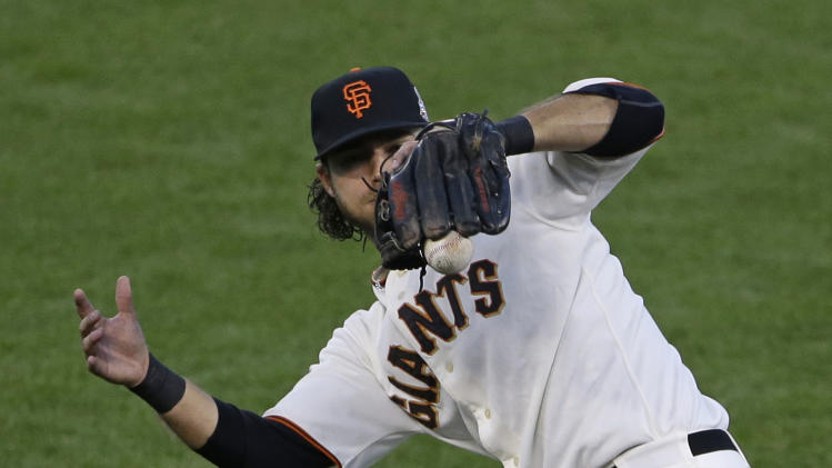 San Francisco Giants shortstop Brandon Crawford tries to make a play on a ball hit by Detroit Tigers' Omar Infante during the fourth inning of Game 2 of baseball's World Series Thursday, Oct. 25, 2012, in San Francisco. (AP Photo/Jeff Chiu)