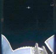This image provided by NASA-TV shows the SpaceX Dragon commercial cargo craft taken from Canadarm2's video camera as Dragon approaches the International Space Station Friday May 25, 2012. In foreground is a portion of Canadarm2. Expedition 31 Flight Engineers Don Pettit and Andre Kuipers will use the Canadarm2 robotic arm to grapple the supply ship early Friday morning with the berthing to the Earth-facing side of the station's Harmony node following about 11:20 a.m. Dragon is scheduled to spend about a week docked with the station before returning to Earth on May 31 for retrieval. (AP Photo/NASA)