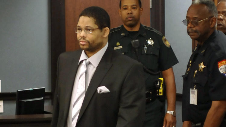 FILE - In this April 22, 2013 file photo, Bartholomew Granger, left, enters court for the start of his trial in Galveston, Texas. The Houston man who admitted shooting his daughter outside a Texas courthouse was convicted Tuesday, April 30, of capital murder for the death of a 79-year-old bystander. Granger said he was angry with his daughter for testifying against him in a sex assault case. (AP Photo/The Beaumont Enterprise, Dave Ryan)