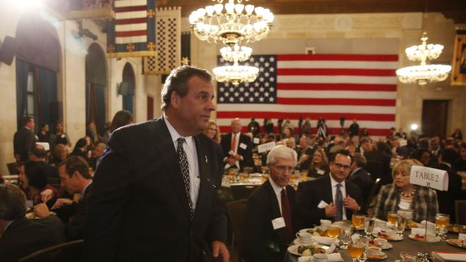 New Jersey Governor Christie walks in before making remarks at a legal reform awards luncheon at the U.S. Chamber of Commerce in Washington