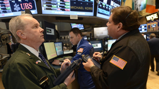 James Riley, left, of Dag Securities works  on the floor of the New York Stock Exchange, Wednesday, Feb. 13, 2013 in New York. (AP Photo/Henny Ray Abrams)