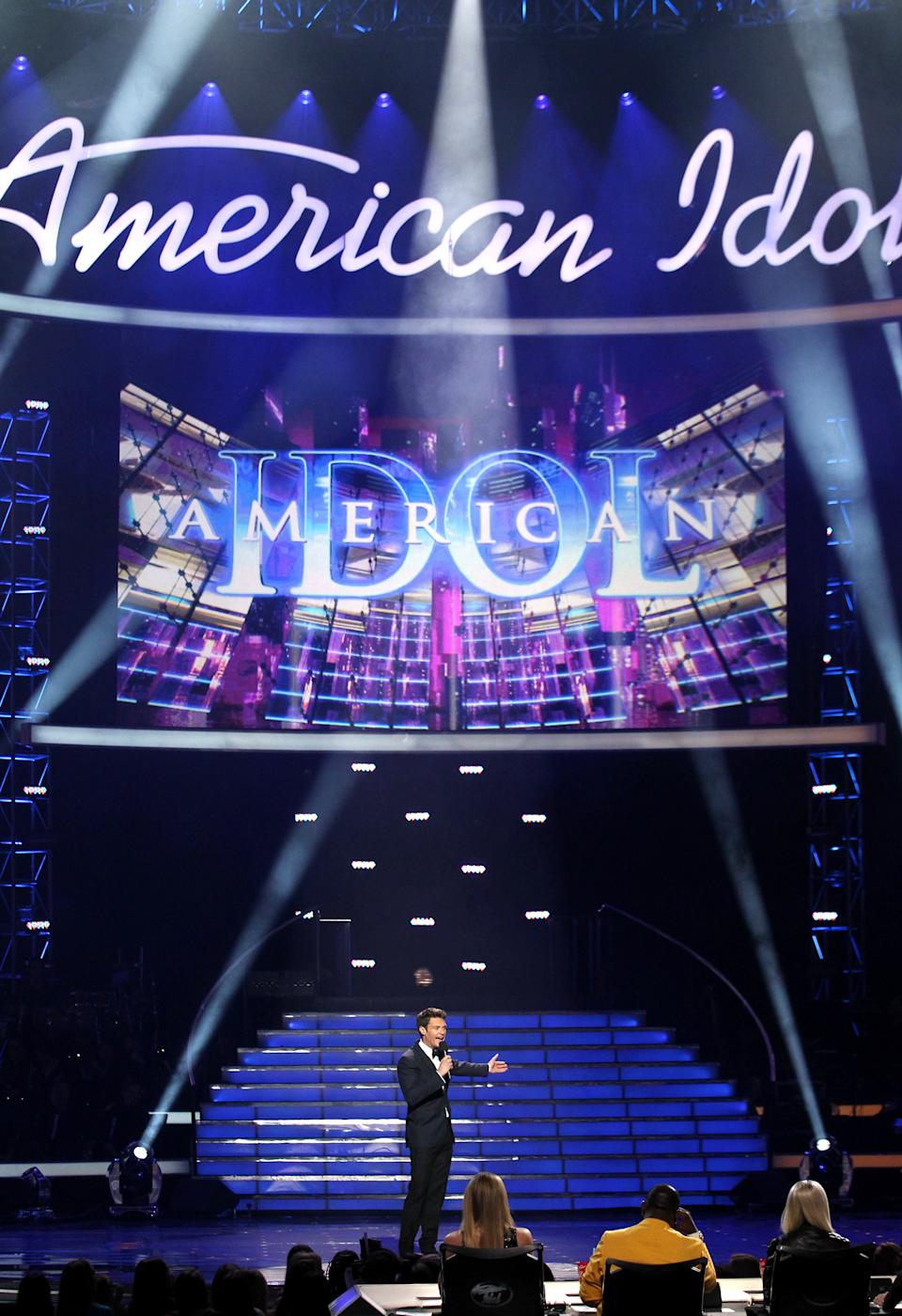 "Host Ryan Seacrest speaks on stage at the ""American Idol"" finale at the Nokia Theatre at L.A. Live on Thursday, May 16, 2013, in Los Angeles. (Photo by Matt Sayles/Invision/AP)"