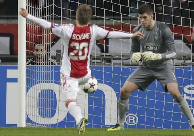 Celtic goalkeeper Fraser Forster, right, saves ahead of Ajax's Lasse Schone during the Champions League Group H soccer match between Ajax Amsterdam and Celtic Glasgow at ArenA stadium in Amsterdam, Ne