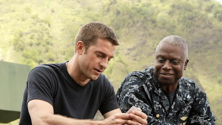 "This image released by ABC shows Scott Speedman as Sam Kendal, left, and Andre Braugher as Captain Marcus Chaplin in a scene from the series ""Last Resort,"" premiering Sept. 27, 2012 at 8 p.m. EST on ABC. (AP Photo/ABC, Mario Perez)"