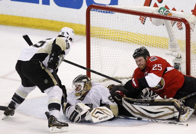 Penguins goalie Vokoun makes a save as Senators' Neil falls on him during the third period in Game 3 of their NHL Eastern Conference semi-final playoff hockey game in Ottawa