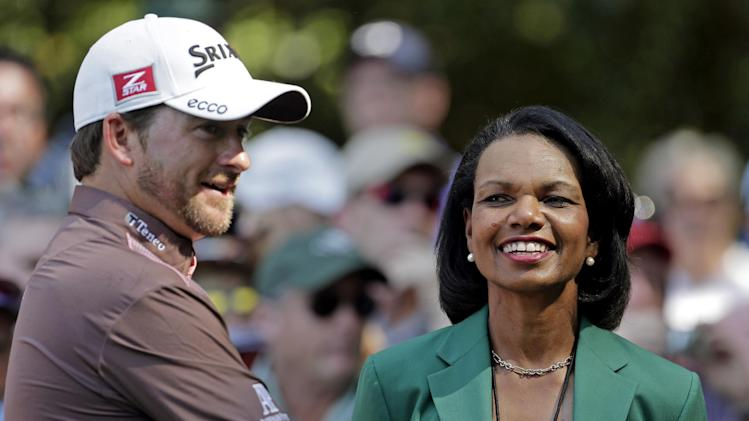 Former Secretary of State Condoleezza Rice speaks with Graeme McDowell, of Northern Ireland, during the par three competition before the Masters golf tournament Wednesday, April 10, 2013, in Augusta, Ga. (AP Photo/Charlie Riedel)
