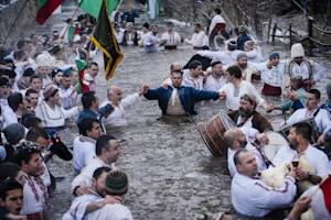Men dance in the icy winter waters of the Tundzha river…