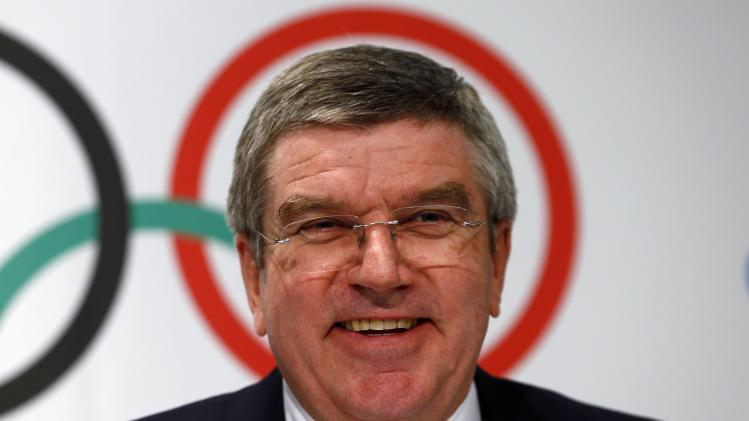 IOC President Bach smiles during a news conference at the IOC headquarters in Lausanne