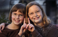In a Monday, Nov. 7, 2011 photo, twin sisters Betsy, left, and Katie Overman pose for a photo in Madison, Wisc. The twins will turn 11 on Nov. 11, 2011, or 11/11/11. (AP Photo/Wisconsin State Journal, Craig Schreiner)