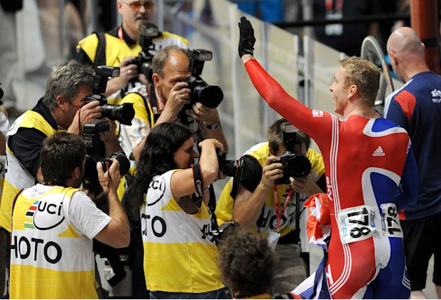 Chris Hoy of Britain (R) celebrates winning the gold medal in the men's keirin at the 2012 Track Cycling World Championships in Melbourne, on April 8, 2012.  IMAGE STRICTLY RESTRICTED TO EDITORIAL