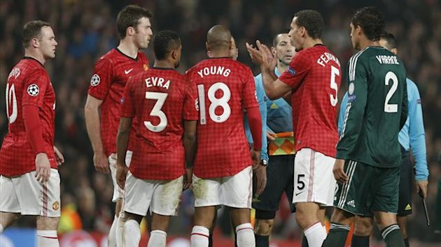 Manchester United's Rio Ferdinand (2nd R) applauds the match officials after the Champions League soccer match against Real Madrid at Old Trafford stadium in Manchester (Reuters)
