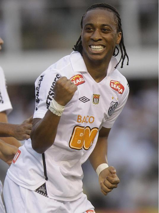 In this May 15, 2011 file photo, Santos' Arouca celebrates after scoring against Corinthians, during their Sao Paulo league soccer final match, in Santos, Brazil.  Arouca, who played for Brazil&#3