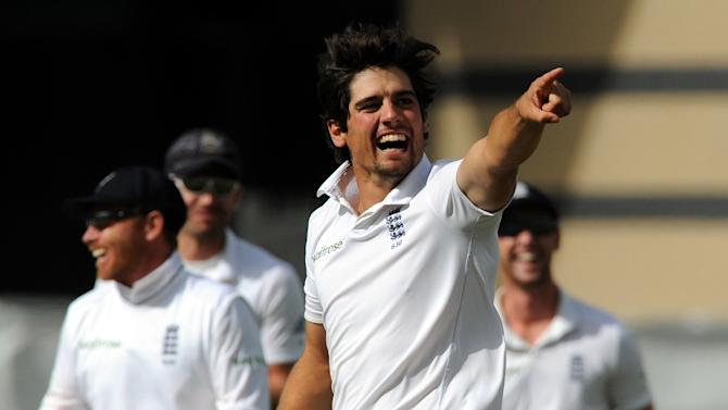 England's Alastair Cook celebrates after bowling India's Ishant Sharma caught Matt Prior for 13 runs during day five of the first Test between England and India at Trent Bridge cricket ground, Nottingham, England, Sunday, July 13, 2014. (AP Photo/Rui Vieira)
