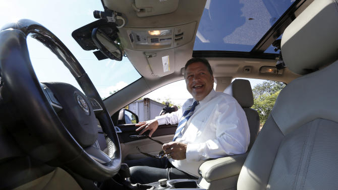 U.S. Rep. Bill Shuster, the chairman of the House Transportation and Infrastructure Committee, gets into a self-driven car in Cranberry, Pa., Butler County, on Wednesday, Sept. 4, 2013. The Cadillac SRX that was modified by Carnegie Mellon University went along local roads and highways operated by a computer that uses inputs from radars, laser rangefinders, and infrared cameras as it made a 33-mile trip to the Pittsburgh International Airport. A Carnegie Mellon engineer was in the driver's seat as a safety precaution. (AP Photo/Keith Srakocic)