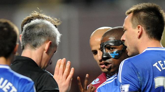 Chelsea's Ramires, right, appeals to referee Christopher Foy about an earlier yellow card during the English Premier League soccer match between Aston Villa and Chelsea at Villa Park, Birmingham, England, Saturday, March 15, 2014. (AP Photo/Rui Vieira)