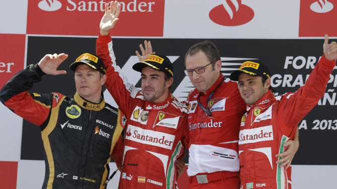 From left, second place Lotus driver Kimi Raikkonen of Finland, winner Ferrari driver Fernando Alonso of Spain, Ferrari team principal Stefano Domenicali and third place Ferrari driver Felipe Massa of Brazil celebrate on the podium after winning the Formula One Spanish Grand Prix, at the Catalunya racetrack in Montmelo, near Barcelona, Spain, Sunday, May 12, 2013. (AP Photo/Luca Bruno)