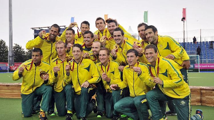 Australia celebrate winning the men's field hockey gold after beating India at the Glasgow National Hockey Centre at the 2014 Commonwealth Games in Glasgow, Scotland, on August 3, 2014