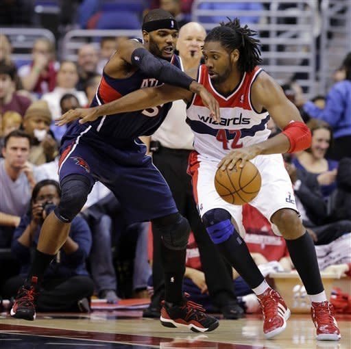 Williams scores 24, Hawks beat Wizards in OT