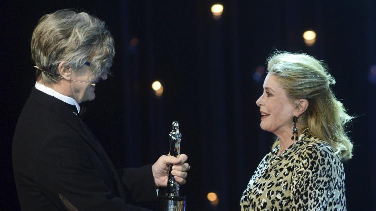 Film director Wenders hands over the trophy for Lifetime Achievement to French actress Deneuve during the European Film Awards ceremony in Berlin