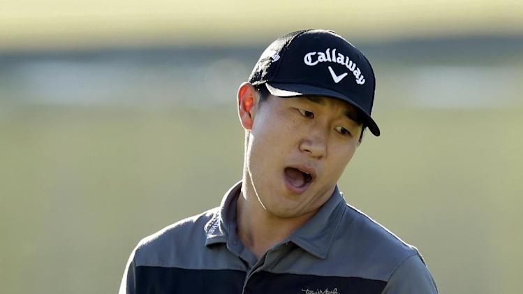 James Hahn reacts after missing a birdie putt on the 18th hole of the Palmer Private Course at PGA West during the first round of the Humana Challenge PGA golf tournament on Thursday, Jan. 17, 2013, in La Quinta, Calif. (AP Photo/Ben Margot)